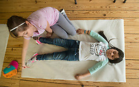 NWA Democrat-Gazette/BEN GOFF @NWABENGOFF<br /> Joslyn Hernandez (right) and Camila Bravo, 4th graders from Brighton Park school in Chicago, take turns tracing each other for a project Friday, April 13, 2018, at Ozark Natural Science Center near Huntsville. The 4th grade students from Brighton Park, a public charter school, are visiting for a five day immersive environmental education program.