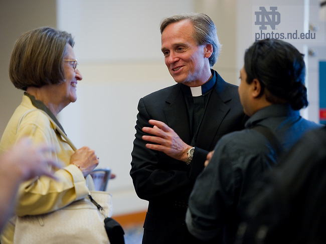 Sept. 20, 2011; Rev. John I. Jenkins, C.S.C. chats with faculty at a reception following his annual address to the faculty...Photo by Matt Cashore/University of Notre Dame