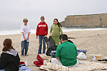Pacific Elementary School Students On Beach Cleanup Talking to Beachgoers About Their Project to Keep The Beaches Clean