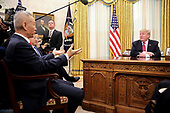 United States President Donald J. Trump listens as Vice Premier Liu He of the People's Republic of China speaks in the Oval Office of the White House on January 31, 2019 in Washington, DC. <br /> Credit: Oliver Contreras / Pool via CNP
