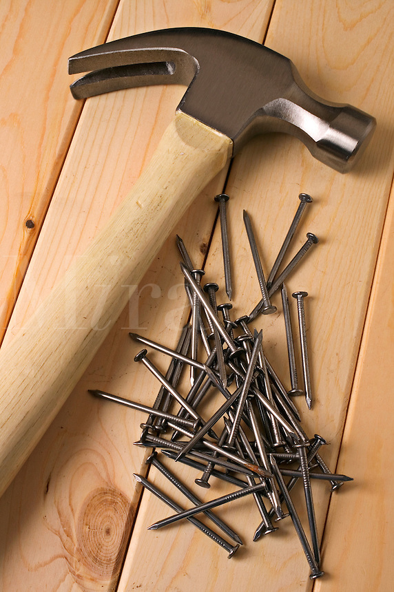 Hammer and nails on board