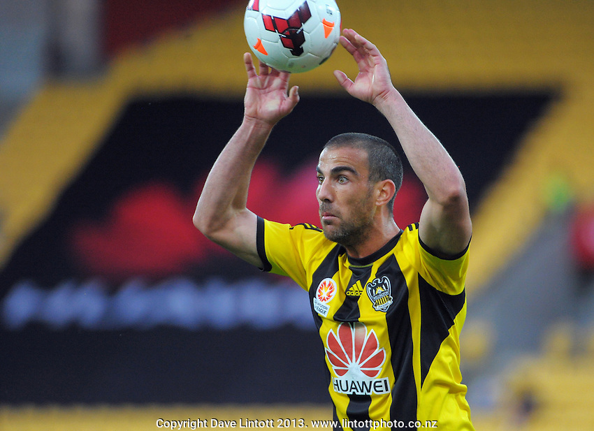 Manny Muscat throws in during the A-League football match between Wellington Phoenix and Sydney FC at Westpac Stadium, Wellington, New Zealand on Sunday, 22 December 2013. Photo: Dave Lintott / lintottphoto.co.nz
