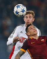 Leverkusen's Christoph Kramer jump for the ball with  AS Roma's Juan Iturbe  during the Champions League Group E soccer match between As Roma and  Bayer Leverkusen at the Olympic Stadium in Rome, November 04 2015