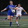 Hope Breslin #11 of Massapequa, right, feels pressure from Sarah Gallagher #27 of Calhoun during the Nassau County varsity girls soccer Class AA final at Cold Spring Harbor High School on Tuesday, Nov. 1, 2016. Massapequa won by a score of 5-1.
