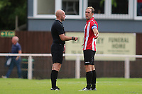Rick Bloy match day referee has words with Elliot Styles to calm things down  during AFC Hornchurch vs Soham Town Rangers, Bostik League Division 1 North Football at Hornchurch Stadium on 12th August 2017