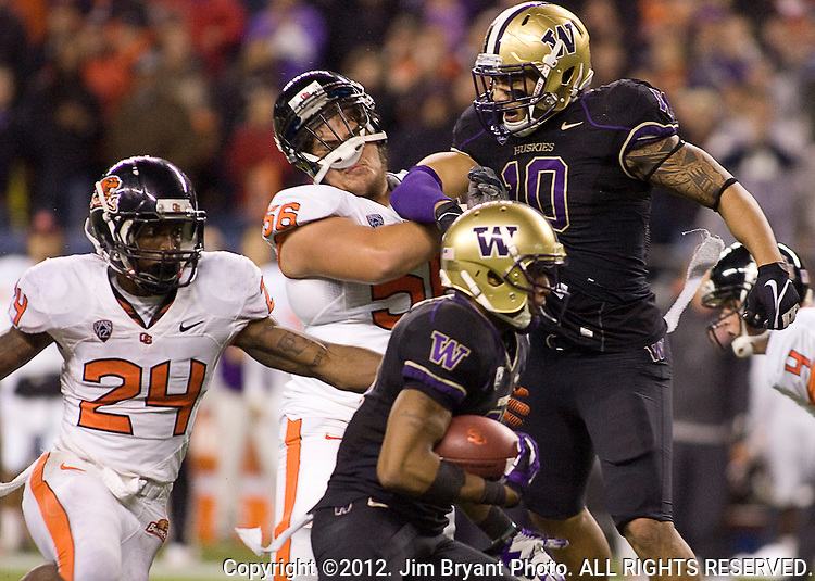 Washington Huskies defensive back  Marcus Peters (21) returns Oregon State Beavers quarterback Sean Mannion interception for 26 yards at CenturyLink Field in Seattle, Washington on October 27, 2012.  The Huskies upset the 7th Ranked Beavers 20-17.  ©2012. Jim Bryant Photo. ALL RIGHTS RESERVED.