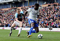 Cardiff City's Bruno Ecuele Manga under pressure from Burnley's Ashley Barnes<br /> <br /> Photographer Rich Linley/CameraSport<br /> <br /> The Premier League - Saturday 13th April 2019 - Burnley v Cardiff City - Turf Moor - Burnley<br /> <br /> World Copyright © 2019 CameraSport. All rights reserved. 43 Linden Ave. Countesthorpe. Leicester. England. LE8 5PG - Tel: +44 (0) 116 277 4147 - admin@camerasport.com - www.camerasport.com