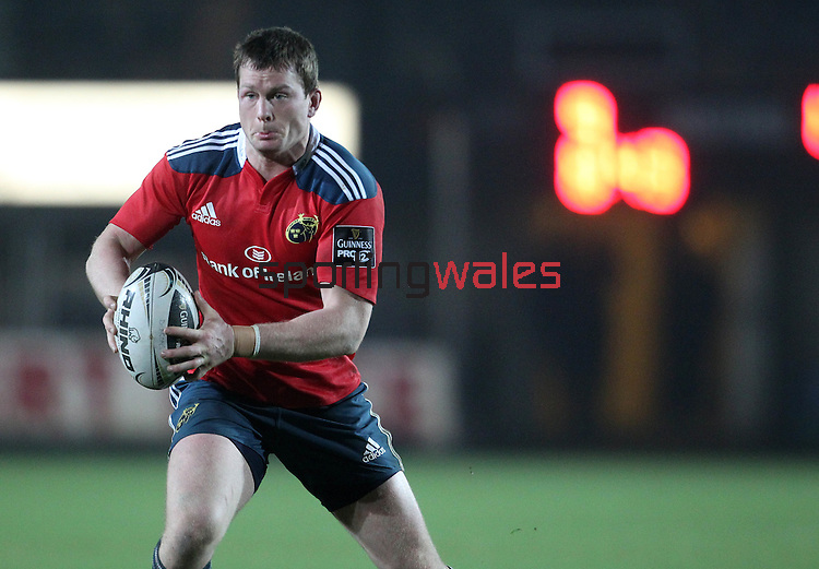 Inside centre Denis Hurley of Munster Rugby carries the ball forward.<br /> <br /> Guiness Pro 12<br /> Newport Gwent Dragons v Munster Rugby<br /> Rodney Parade<br /> 21.11.14<br /> ©Steve Pope-SPORTINGWALES
