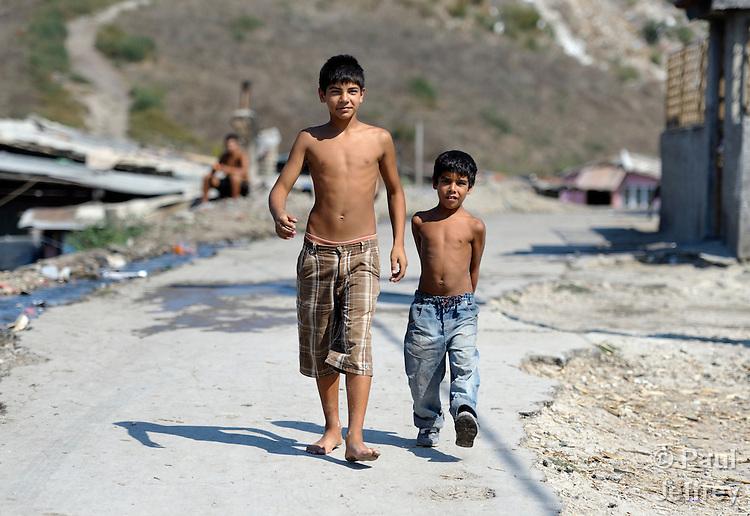 Two boys walk through the Maxsuda neighborhood of Varna, Bulgaria, where many Turkish-speaking Roma live.
