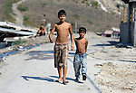Two boys walk through the Maxsuda neighborhood of Varna, Bulgaria, where many Turkish-speaking Roma live.