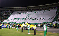 BOGOTA -COLOMBIA, 1 -SEPTIEMBRE-2014. Hinchas de Atletico Nacional alientan a su equipo durante el encuentro contra Seguros La  Equidad   partido de la  septima  fecha  de La Liga Postobón 2014-2. Estadio Nemesio Camacho El Campin . /  Atletico Nacional fans cheer for their team during the game against Equidad Seguros  seventh game of the La Liga Postobón date 2014-2. Estadio Nemesio Camacho El Campin. Photo: VizzorImage / Felipe Caicedo / Staff