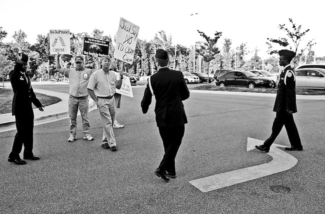 North Point High School JROTC members stop three men holding signs as they walk towards the entrance for House Majority Leader Steny Hoyer's health care reform town hall meeting on Sept. 1, 2009, at North Point High School in Waldorf, Md. Signs were not allowed past a certain point of the line, or inside the event.