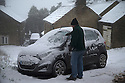 14/01/16<br /> <br /> A man clears snow from his car in Flash in the Derbyshire Peak District near Buxton.<br /> <br /> All Rights Reserved: F Stop Press Ltd. +44(0)1335 418365   +44 (0)7765 242650 www.fstoppress.com