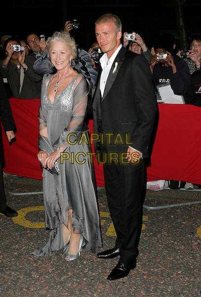 DAME HELEN MIRREN & DAVID BECKHAM.Arrivals - Greatest Britons 2007 Awards Show, .The London Studios, London, Engand, May 21st 2007..full length black suit white shirt waistcoat grey silver floaty dress sequined.CAP/AH.©Adam Houghton/Capital Pictures.