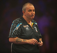 04.01.2015.  London, England.  William Hill PDC World Darts Championship.  Finals Night.  Phil Taylor (2) [ENG] shows his frustration during his game with Gary Anderson (4) [SCO]. Phil Taylor starts attempt to win a 17th title at Alexandra Palace.
