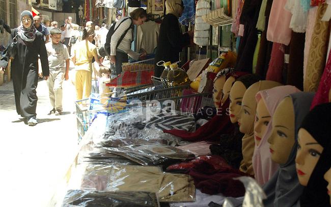 A Palestinians shop in a popular market in the old city of Jerusalem on July 12, 2009. Photo by Mahfouz Abu Turk