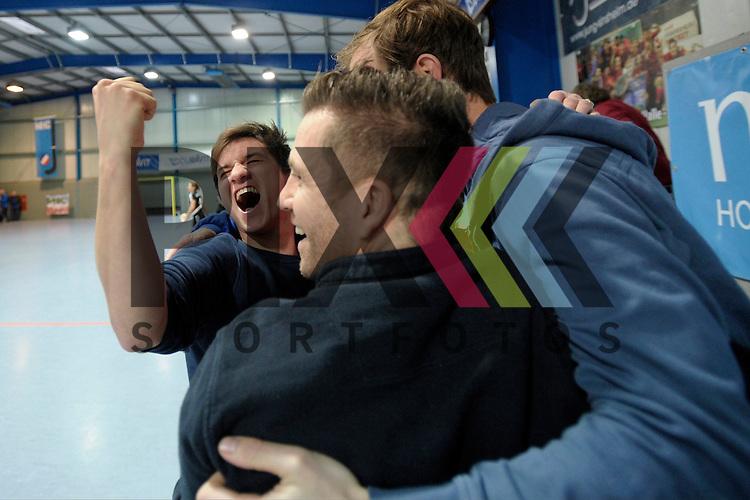GER - Mannheim, Germany, January 30: During the 1. Bundesliga Damen indoor hockey quarter final match between Mannheimer HC (blue) and TuS Lichterfelde (black) on January 30, 2016 at Irma-Roechling-Halle in Mannheim, Germany.   Janick Thum of Mannheimer HC celebrates after winning<br /> <br /> Foto &copy; PIX-Sportfotos *** Foto ist honorarpflichtig! *** Auf Anfrage in hoeherer Qualitaet/Aufloesung. Belegexemplar erbeten. Veroeffentlichung ausschliesslich fuer journalistisch-publizistische Zwecke. For editorial use only.