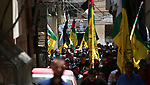 Mourners carry the body of Palestinian assailant Mohammad Marshoud ,30, after Israel released his body, during his funeral at Balata refugee camp near in the West Bank city of Nablus, on July 14, 2018. Photo by Shadi Jarar'ah