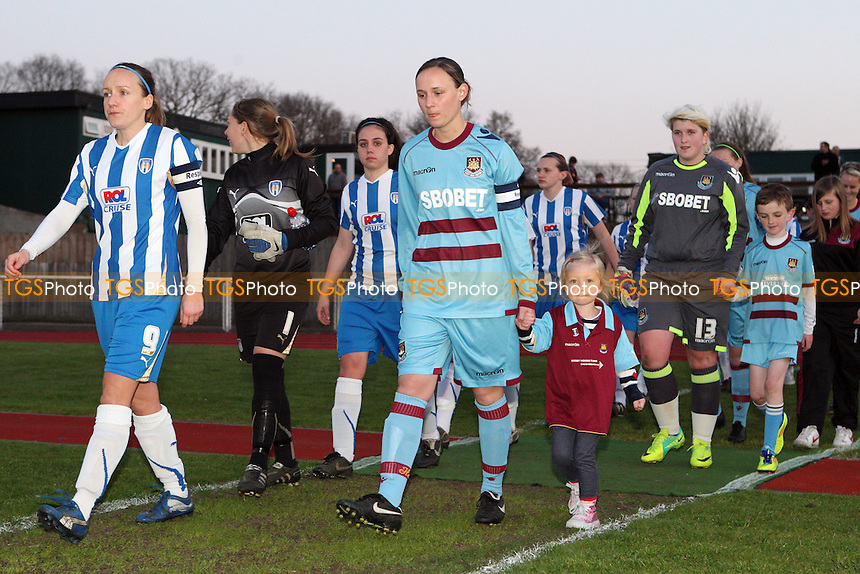 The captains lead the teams out - Colchester United Ladies vs West Ham United Ladies, Essex FA County Cup Final at Bridge Avenue, Hornchurch - 05/04/12 - MANDATORY CREDIT: Rob Newell/TGSPHOTO - Self billing applies where appropriate - 0845 094 6026 - contact@tgsphoto.co.uk - NO UNPAID USE..