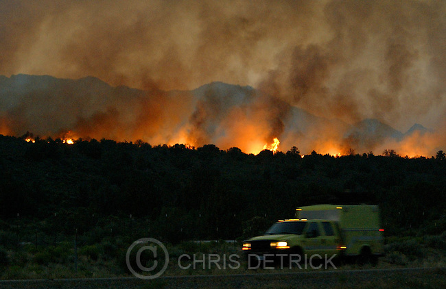 Toquerville,Utah--6/25/2005- .An emergency vehicle travels South on I-15 past the burning Blue Springs fire near Toquerville, Ut.  Over 5,000 acres have burned so far. .Photo By: Chris Detrick /Salt Lake Tribune.File #Blue Springs Fire CD01