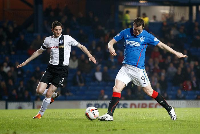 Jon Daly tries to toe poke the ball past Gordon Pope