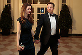 Elon Musk, co-founder and chief executive officer of Tesla Motors Inc., right, and Talulah Musk arrive to a state dinner hosted by U.S. President Barack Obama and U.S. First Lady Michelle Obama in honor of French President Francois Hollande at the White House in Washington, D.C., U.S., on Tuesday, Feb. 11, 2014. Obama and Hollande said the U.S. and France are embarking on a new, elevated level of cooperation as they confront global security threats in Syria and Iran, deal with climate change and expand economic cooperation. <br /> Credit: Andrew Harrer / Pool via CNP