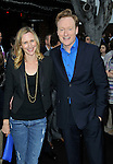 Conan O'Brien and wife Liza Powel arriving at the Los Angeles premiere of Super 8, held at the Regency Village Theater, June 8, 2011. Fitzroy Barrett