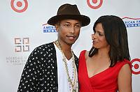 Pharrell Williams and Soledad O'Brien at the 2nd annual New Orleans in the Hamptons Benefit gala on July 27, 2012 in Bridgehampton, New York. &copy;&nbsp;mpi96/MediaPunch Inc. *NOrtePhoto.com<br /> <br /> **SOLO*VENTA*EN*MEXICO**<br />  **CREDITO*OBLIGATORIO** *No*Venta*A*Terceros*<br /> *No*Sale*So*third* ***No*Se*Permite*Hacer Archivo***No*Sale*So*third*&Acirc;&copy;Imagenes*con derechos*de*autor&Acirc;&copy;todos*reservados*.