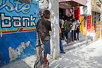 A boy stands outside a barber shop crowded with people watching Spain play the Netherlands in the World Cup final on July 11, 2010 in Port-au-Prince, Haiti.