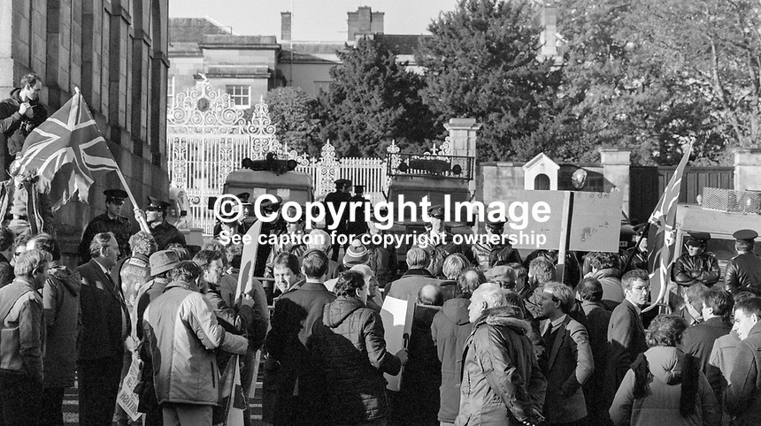Press conference following signing of Anglo-Irish Agreement by Margaret Thatcher, Prime Minister, UK, and Garret Fitzgerald, Prime Minister, An Taoiseach, Rep of Ireland, at Hillsborough Castle, N Ireland, 15th November 1985. Police hold back a small number of anti-agreement protesters outside Hillsborough Castle. 1985111505g.<br />