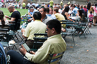 A reader uses his Sony ereader electronic book in Bryant Park in New York on Tuesday, July 24, 2012 (© Richard B. Levine)