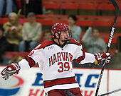 Brian Hart (Harvard - 39) celebrates Rempel's first collegiate goal. - The Harvard University Crimson defeated the visiting Brown University Bears 3-2 on Friday, November 2, 2012, at the Bright Hockey Center in Boston, Massachusetts.