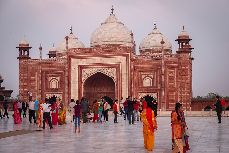 Several red sandstone and marble structures are found surrounding the main Taj Mahal mausoleum.