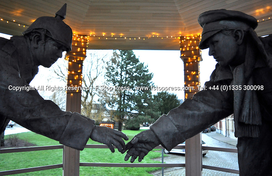 "25/12/14<br /> <br /> A sculpture depicting two WW1 soldiers playing football during the famous Christmas Day truce is displayed in the field near Messine, Belgium, close to where the match was played in Flanders, Belgium.<br /> <br /> The sculpture, made in England, arrived in Flanders on Christmas Eve, and was first displayed in the town centre before being taken to the spot where the match was played. <br /> <br /> Sculpted by Andy Edwards the work is entitled 'All Together Now', recalling the song by the band The Farm - which was inspired by the truce. <br /> <br /> Chris Butler said: ""Castle Fine Arts are proud to have cast a number of war memorials over the years. We are honoured to support this sculpture for peace. I believe it will touch the hearts of millions.""<br /> <br /> <br /> ""It will be a symbol of peace and hope and a call for a renewed worldwide cessation of violence in honour of those brave boys who 'joined together and decided not to fight'"".<br /> <br /> <br /> The statue depicts the meeting of a British and a German soldier over a football, deep in the mud between the lines on that first Christmas of the war. The soldiers appear to be shaking hands but  are not not quite touching, forming a space in which a visitor can insert their own hand to complete the union.  A chance for a moments reflection on how far we are from true peace and brotherhood and the part each of us has to play in that dream. We want the work to stand as both a celebration of this inspirational and heroic event and as symbol of hope and peace. <br /> <br /> The project was instigated some years ago, with the support of the Football Asscociation (FA), as football's contribution to the First World War commemorations. <br /> <br /> All Rights Reserved - F Stop Press. www.fstoppress.com. Tel: +44 (0)1335 300098"