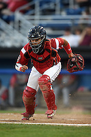 Batavia Muckdogs catcher Rodrigo Vigil (27) retrieves a pitch in the dirt during a game against the Brooklyn Cyclones on August 9, 2014 at Dwyer Stadium in Batavia, New York.  Batavia defeated Brooklyn 4-2.  (Mike Janes/Four Seam Images)