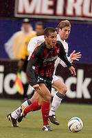 The MetroStars' Craig Ziadie is chased by New England Revolution's Steve Ralston. The New England Revolution played the NY/NJ MetroStars to a 1 to 1 tie at Giant's Stadium, East Rutherford, NJ, on April 25, 2004.