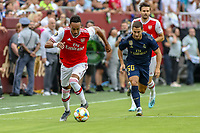 Landover, MD - July 23, 2019: Arsenal Pierre-Emerick Aubameyang (14) steals the ball from Real Madrid Eden Hazard during the match between Arsenal and Real Madrid at FedEx Field in Landover, MD.   (Photo by Elliott Brown/Media Images International)