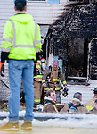 MIDDLEBURY,  CT-122716JS05--Middlebury firefighters exit a two-family home at 165 Whittemore Road in MIddlebury on Tuesday after battling the fatal fire. <br /> Jim Shannon Republican-American