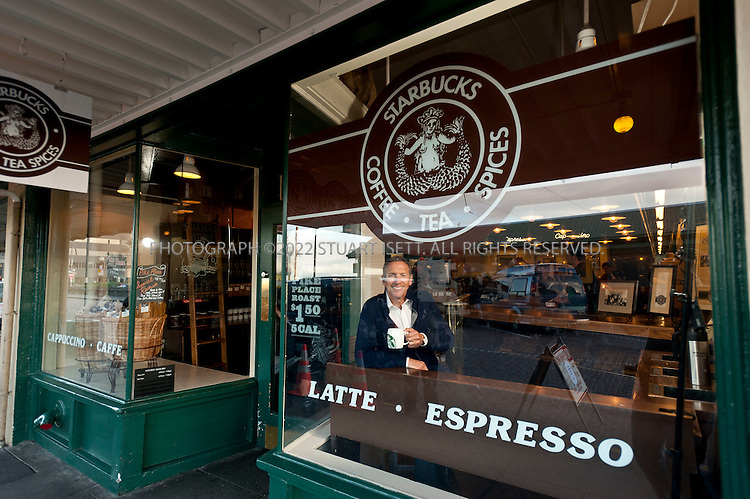 2/16/2011--Seattle, WA, USA...Howard Schultz has a key that opens the Starbucks at Pike Place Market (1912 Pike Place), in Seattle, WASH., and he often comes in the early mornings and lets himself into the store. Starbucks opened its first store in 1971 in the Market in downtown Seattle.  Because the Market is a historic district with design guidelines, the store retains its original look...©2011 Stuart Isett. All rights reserved.