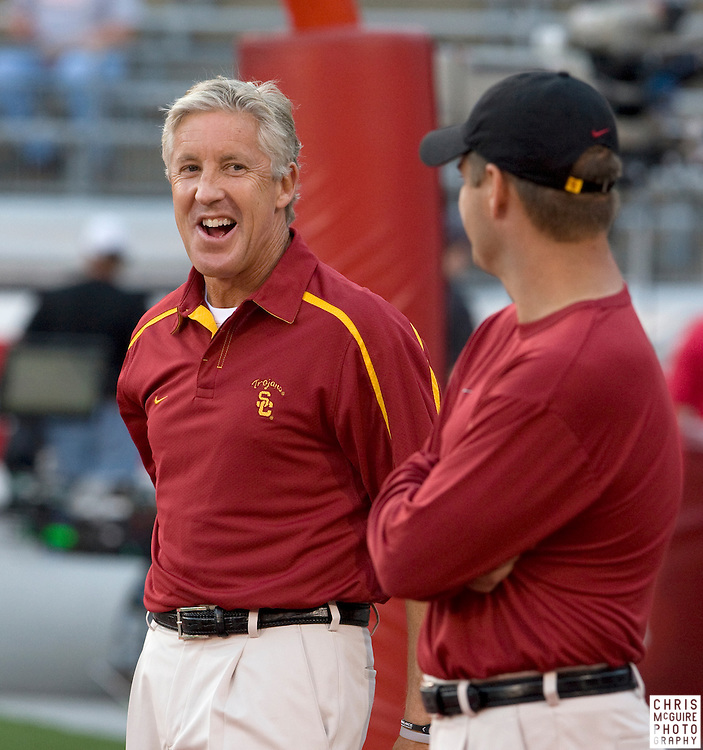 12 September 2009:  Football -- USC head coach Pete Carroll laughs with offensive coordinator Jeremy Bates before their game at Ohio Stadium in Columbus.  USC won 18-15.  Photo by Christopher McGuire.