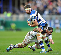 Guy Mercer is tackled in possession. Amlin Challenge Cup quarter-final, between Bath Rugby and CA Brive on April 6, 2014 at the Recreation Ground in Bath, England. Photo by: Patrick Khachfe / Onside Images