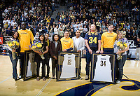 California seniors' Bak Bak, Brandon Smith and Robert Thurman pose together with their elatives and Coach Montgomery for group pictures before the game against Stanford at Haas Paviliion in Berkeley, California on March 6th, 2013.  Stanford defeated California, 83-70.