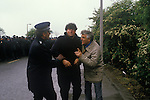 Miners Strike. Orgreave Near Rotherham Yorkshire 1984. Miner helped away from the picket line by police inspector and colleague. He was not arrested.