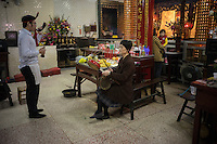 Believers perform a Taoist ceremony at the Temple of the Jade Emperor in Tainan, Taiwan, 2015.