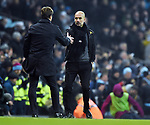 Manchester City Manager Josep Guardiola shakes hands withTottenham Hotspur Manager Mauricio Pochettino at the end of the the premier league match at the Etihad Stadium, Manchester. Picture date 16th December 2017. Picture credit should read: Robin ParkerSportimage