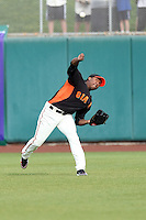 Francisco Peguero #62 of the San Francisco Giants makes a throw from centerfield against the Arizona Diamondbacks in the first spring training game of the season at Scottsdale Stadium on February 25, 2011  in Scottsdale, Arizona. .Photo by:  Bill Mitchell/Four Seam Images.