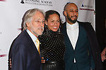 (L-R) Recording Academy President and CEO Neil Portnow, Alicia Keys and her husband Swizz Beatz arrive at the Recording Academy Producers & Engineers Wing event honoring Alicia Keys and Swizz Beatz at 30 Rockefeller Plaza in New York City, during Grammy Week on January 25, 2018.