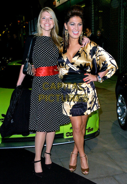 VANESSA NIMMO & NADIA ALMADA .The Gumball 3000 Miles - film premiere, KOKO, London, UK..November 30th, 2006.full length big brother black white red gold pattern print polka dot dress wrap hand on hip.CAP/CAN.©Can Nguyen/Capital Pictures