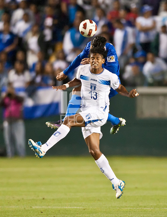 CARSON, CA – June 6, 2011: Honduras player Carlo Costly (13) heads the ball during the match between Guatemala and Honduras at the Home Depot Center in Carson, California. Final score Guatemala 0, Honduras 0.