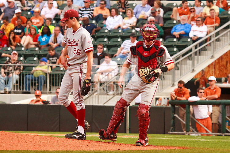 AUSTIN, TEXAS-March 4, 2011:  Starter Mark Appel of Stanford discusses the situation with Catcher Zack Jones during the game against the Texas Longhorns, at Disch-Falk field in Austin, Texas. Texas defeated Stanford 4-3.